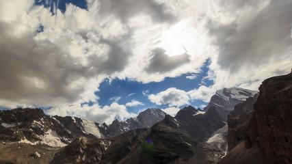 Valley of the Sun. Zoom. Clouds blurred. Tajikistan. 4K