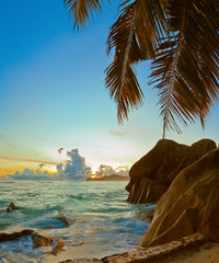 Sunset on beach Source D'Argent at Seychelles