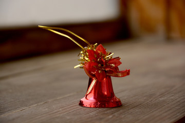 Christmas decoration red bell on wooden table