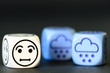 concept of sad snow / winter weather - emoticon and weather dice