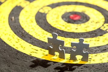 Two Jigsaw Puzzle Pieces on Old Yellow Target