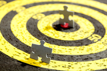 Jigsaw Puzzle Piece on Old Yellow Target