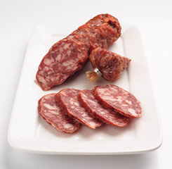 Spanish sausage on white tray