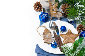 Christmas table setting with wooden decorations, isolated