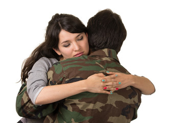 young woman and soldier in military uniform say goodbye