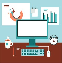 office desk with computer and graphics illustration