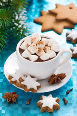 hot chocolate with marshmallows on a blue background, vertical