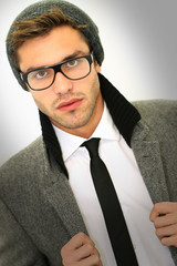 Trendy guy with winter coat, hat and eyeglasses, isolated