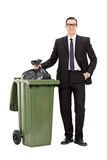 Young businessman taking out the trash