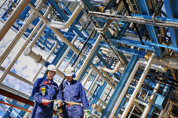 oil, gas and industry workers in powerful color concept