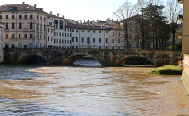 pusterla bridge with bacchiglione river in the vicenza city in i