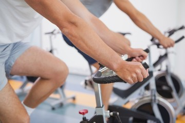 Fit people working out on the exercise bikes