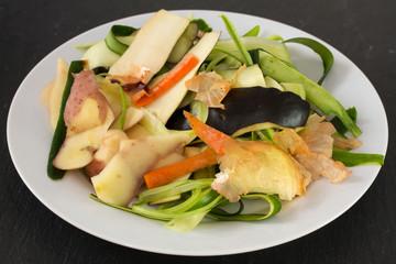 vegetable skin in white dish