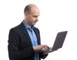 bald businessman working on his laptop
