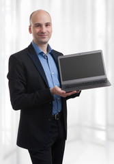 Businessman presenting laptop