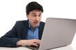 shocked man with laptop