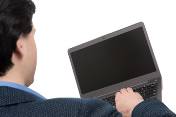 rear view of a man using laptop