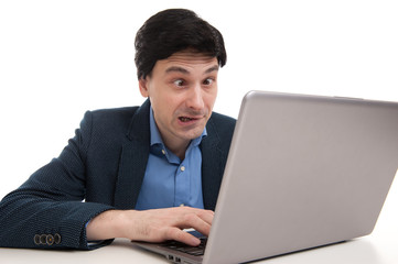 shocked man with laptop