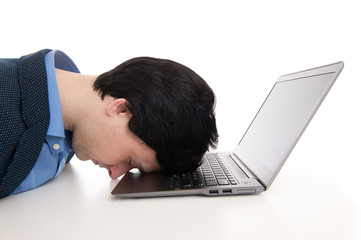overworked businessman sleeping on his laptop
