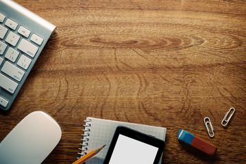 Devices and School Supplies on Wooden Table