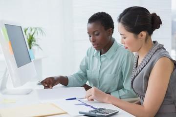 Businesswomen working together at desk