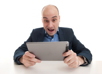 shocked man with tablet computer