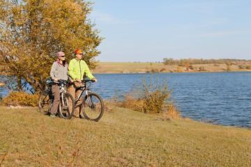 Happy  mountain bike couple cycling outdoors a country walk near
