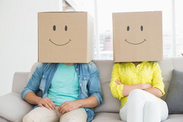 Young creative team wearing boxes on head