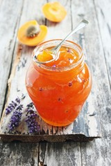 Homemade delicious apricot jam on rustic wooden table