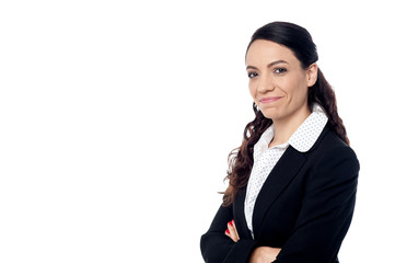 Smiling business woman with folded arms
