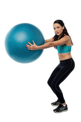 Woman worksout with fitness ball