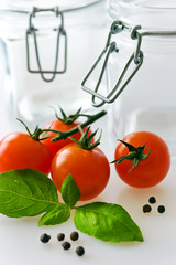 fresh red tomatoes with basil leaf and juice