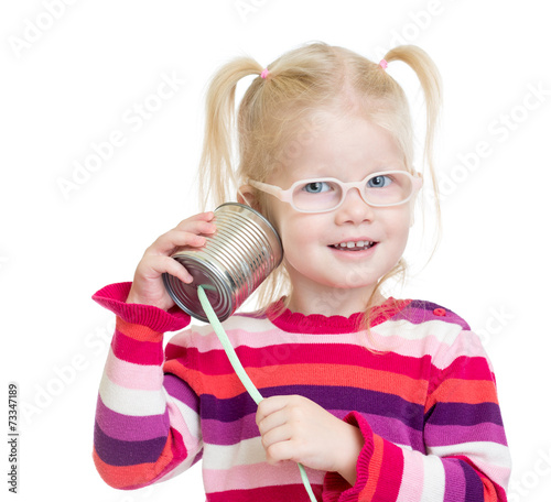 canvas print picture Funny kid in eyeglasses with can as a telephone isolated