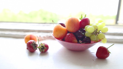 different Summer fruits on a window sill