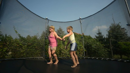 Children enjoy jumping on trampoline