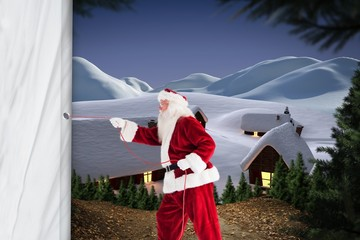 Composite image of santa pulls something with a rope