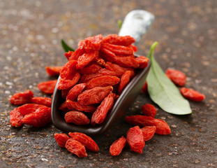 useful red goji berries on a old iron background