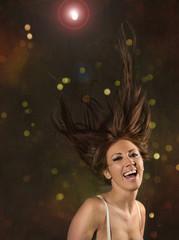 Partytänzerin mit wild fliegenden Haaren
