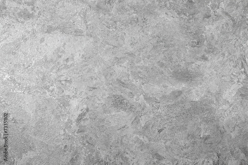 Grungy gray background of decorative stucco - 73351102