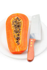 Half of papaya with Knife isolated