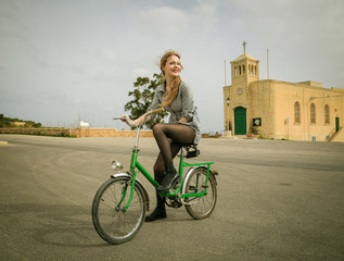 Graceful girl riding a bike