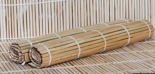 Two bamboo mats on kitchen table