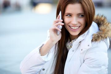 beautiful woman talking on the phone