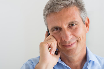 Mature Man Talking On Cellphone