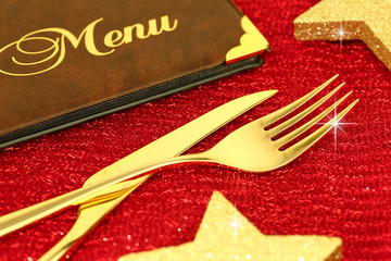 Christmas golden cutlery and restaurant menu