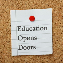 The phrase Education Opens Doors on a notice board