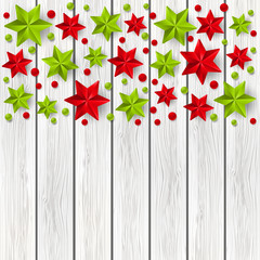 Xmas starry decorations on white wooden background