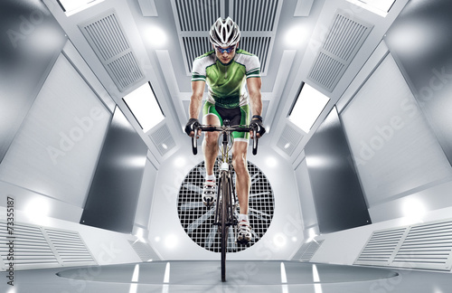 canvas print picture Sport. Cyclist has a traning in the wind tunnel