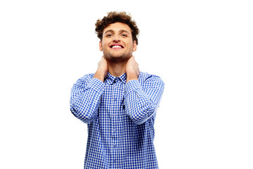 Happy relaxed man touching his neck over white background