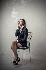 Businesswoman smoking